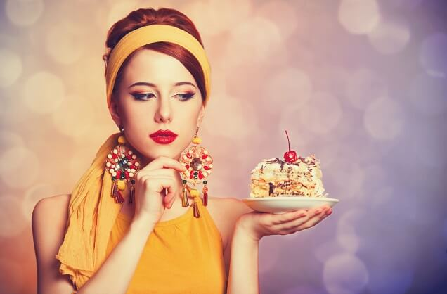Woman looking at piece of cake