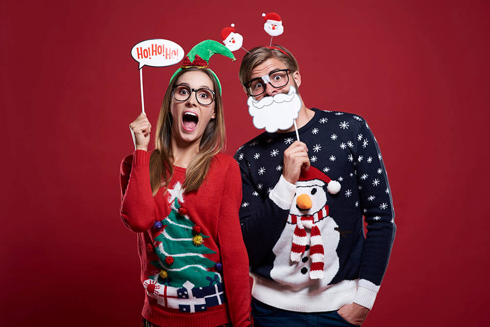 Man and woman dressed in festive Christmas costumes